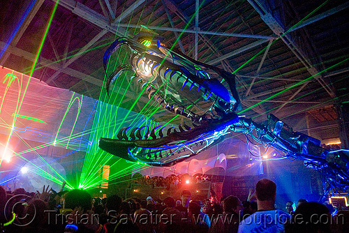 giant snake skeleton animated sculpture - opulent temple massive rave party (treasure island, san francisco) - serpent mother, art installation, fangs, flaming lotus girls, giant, green laser, head, laser lightshow, laser show, lasers, night, nightclub, opulent temple, rave party, sculpture, serpent mother, skeleton, snake, teeth