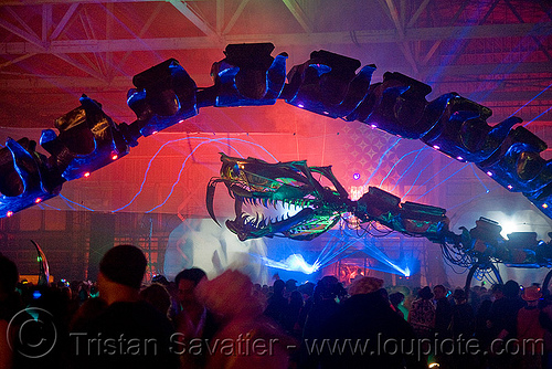 giant snake skeleton animated sculpture - opulent temple massive rave party (treasure island, san francisco) - serpent mother, art installation, flaming lotus girls, giant, green laser, laser lightshow, laser show, lasers, night, nightclub, opulent temple, rave party, sculpture, serpent mother, skeleton, snake