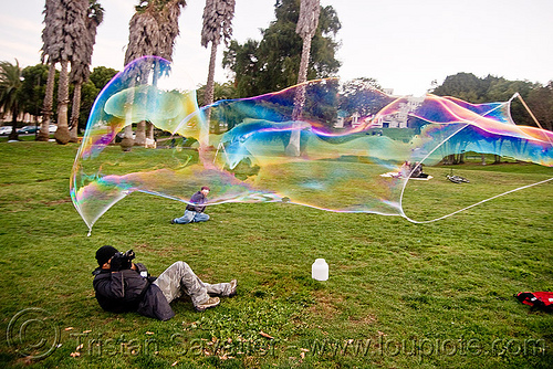 giant soap bubble, big bubble, giant bubble, iridescent, lawn, park, photographer, soap bubbles