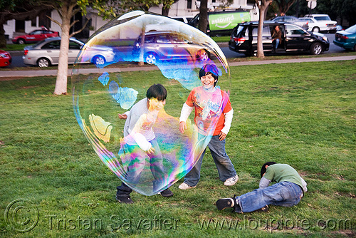 giant soap bubble, big bubble, bubbles, children, dolores park, giant bubble, iridescent, kids, people, playing, soap bubbles, turf