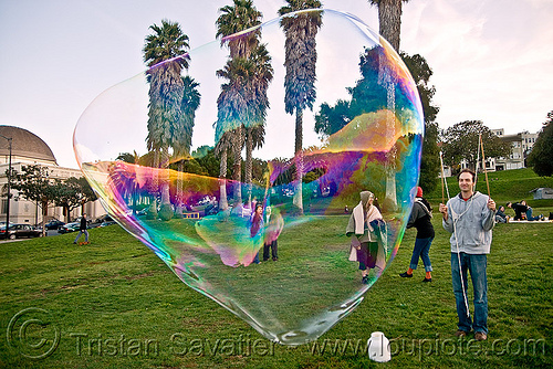 giant soap bubble in dolores park, big bubble, giant bubble, iridescent, lawn, park, soap bubbles