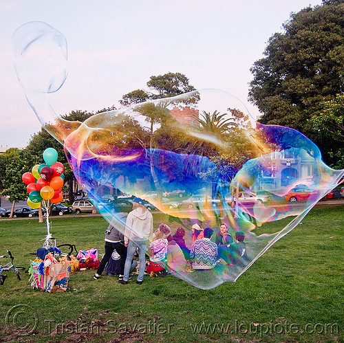 giant soap bubble with weird shape, balloons, big bubble, giant bubble, iridescent, lawn, park, soap bubbles