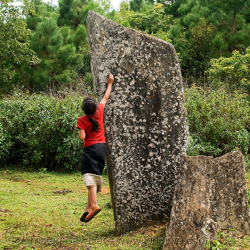 girl catching cicada on menhir (laos), archaeology, cenotaph, child, hintang archaeological park, hintang houamuang, kid, megaliths, menhirs, monoliths, san kong phanh, standing stones