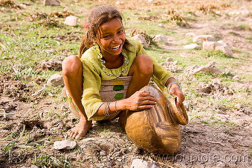girl cleaning water jar - mandu (india), girl, mandav, mandu, water jar, water pot