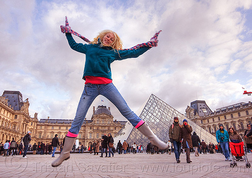 girl jumping at le louvre pyramid, blonde, clouds, crowd, jump shot, le louvre, paris, pyramid, scarf, spread legs, tourists, woman