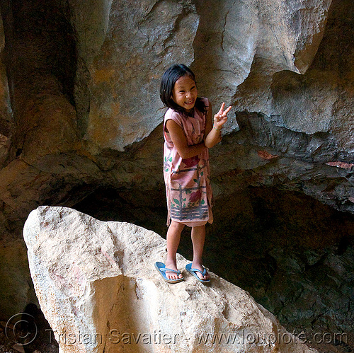 girl on rock (laos), girl, peace sign, rock, v sign, viang xai
