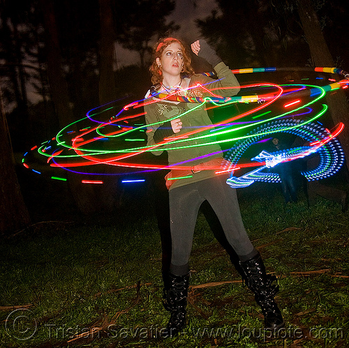 girl spinning a hula hoop with photon LED lights, full moon party, glowing, golden gate park, hooper, hula hooping, led hoop, led hulahoop, led-light, light hoop, long exposure, microlights, night, people, phoenix, rave lights, woman