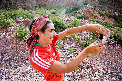 girl taking photo - pilar pitòn, adidas, digital camera, head-band, iruya, noroeste argentino, pilar, quebrada de humahuaca, red, taking photo, woman