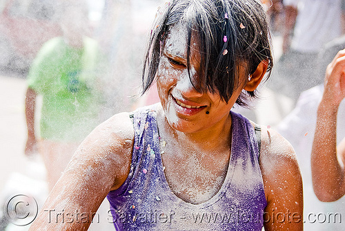 girl with confetti and white talk powder, andean carnival, carnaval, confettis, jujuy capital, noroeste argentino, san salvador de jujuy, serpentine throws, talk powder, white, woman