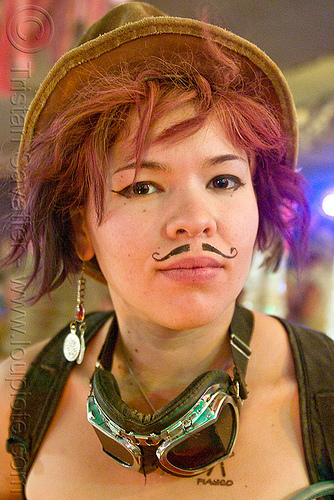 girl with fake mustache, asian woman, burning man, fake moustache, fake mustache, false moustache, false mustache, goggles, hat, makeup, redhead, roxy doll