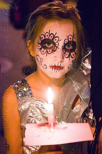 girl with skull makeup - dia de los muertos - halloween (san francisco), candle, child, day of the dead, face painting, facepaint, kid, little girl, night, people, sugar skull makeup, woman