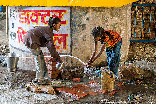 girls washing hands at water hose, bridge pillar, children, daraganj, hindu pilgrimage, hinduism, india, jerrycan, kids, little girl, maha kumbh mela, plastic pipe, plastic piping, washing, water hose, water pipe
