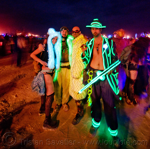 glowing and EL-wire costumes - lisa, casson and friends - burning man 2009, art, casson trenor, el-wire costume, gangster, glow costumes, glowing costumes, gun, hand gun, lisa wong, machine gun, night, people, shot gun, thompson submachine gun, tommy gun