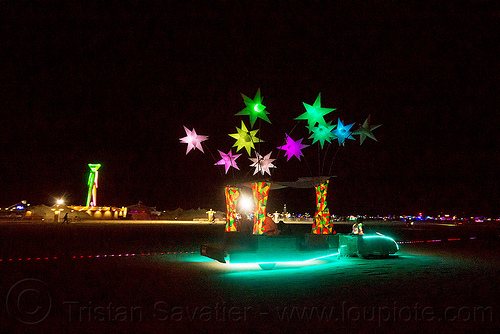 glowing art car with color stars - cool wind - burning man 2015, cool wind art car, inflatable, inflatable stars, light stars, night