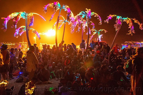 glowing palm trees art car - burning man 2016, art car, burning man, crowd, glowing, night, palm trees, unidentified art