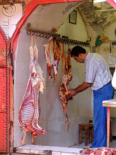 goat carcasses in meat shop, butcher, carcass, carcasses, chevon, cutting, goat meat, halal meat, hanging, knife, kurdistan, man, mardin, meat market, meat shop, mutton, raw meat, worker
