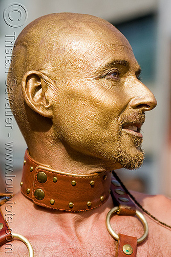 golden face paint, bald, collar, costume, leather, makeup, man