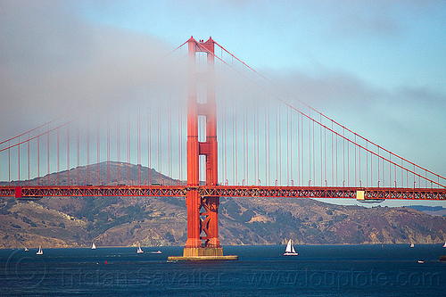 golden gate bridge in the fog, angel island, boats, bridge pillar, bridge tower, coast, fog bank, golden gate bridge, hill, north tower, ocean, sailboats, san francisco bay, sea, suspension bridge