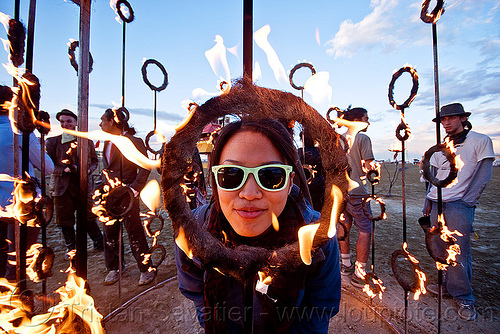 grace liew - burning man 2010, burning man, dusk, fire, flames, grace, rings, sculpture, sunglasses, woman