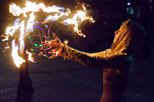 grace spinning fire fans, fire dancer, fire dancing, fire fans, fire performer, fire spinning, grace hoops, hood, hoodie, hoody, night, woman
