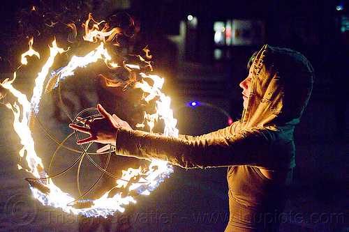 grace spinning fire fans, fire circle, fire dancer, fire dancing, fire fans, fire performer, fire spinning, flames, grace hoops, hood, hoodie, hoody, night, ring, woman
