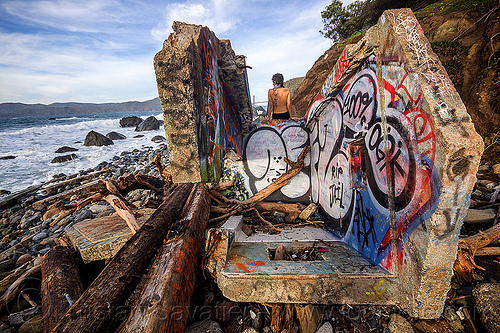 graffiti on concrete ruins on seashore, abandoned, concrete, driftwood, graffiti, ocean, rocks, ruins, sea, seashore, shore, sitting, water, woman, yassmine