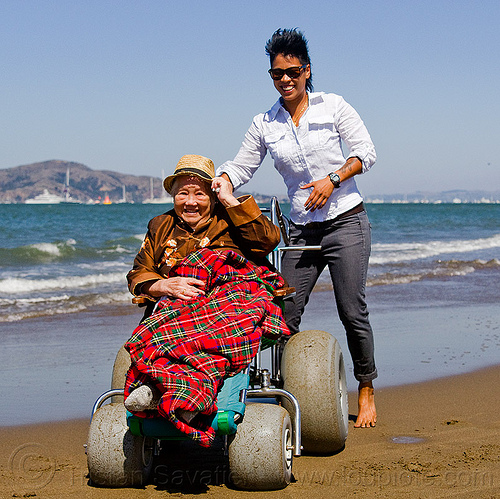 grandma and granddaughter at the beach - beach wheelchair, beach wheelchair, blanket, chinese, crissy field beach, family, grandma, grandmother, jenn, old woman, sand, senior, straw hat, women