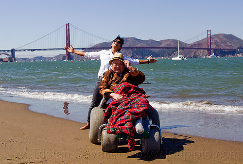 grandma and granddaughter at san francisco beach - wheelchair, beach wheelchair, blanket, chinese, crissy field beach, family, golden gate bridge, grandma, grandmother, jenn, old woman, sand, senior, straw hat, suspension bridge, women
