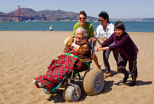 grandma on beach wheelchair at the beach, beach wheelchair, blanket, caretaker, chinese, crissy field beach, family, golden gate bridge, grandma, grandmother, jenn, ocean, old woman, pushing, rolling, sand, sea, senior, straw hat, suspension bridge, water, women