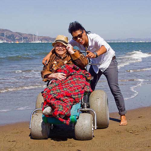 grandma on beach wheelchair with granddaughter, beach wheelchair, blanket, chinese, crissy field beach, family, grandma, grandmother, happy, jenn, ocean, old woman, sand, sea, senior, straw hat, water, women