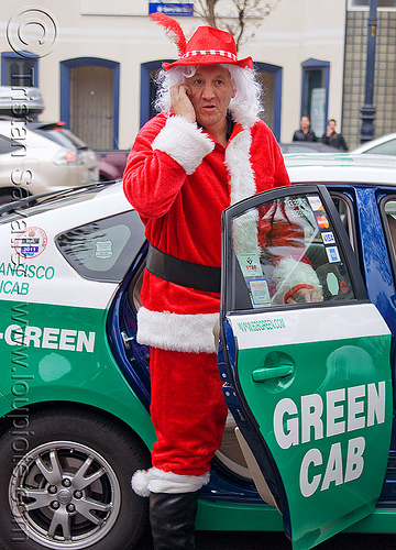 green cab, car, christmas, costumes, man, people, santa claus, santacon, santarchy, santas, taxi, taxi cab