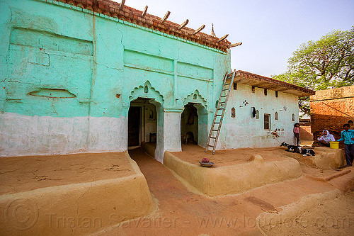 green house with earthen floor patio in indian village, adobe floor, earthen floor, goats, green house, khoaja phool, ladder, people, village, खोअजा फूल