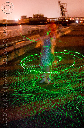 green laser hulahoop - superhero street fair (san francisco), green laser, islais creek promenade, laser hoop, laser hula hoop, night, superhero street fair, woman