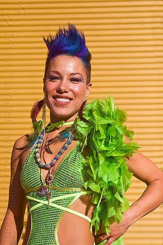 green outfit with green feather boa, blue hair, burning man decompression, fashion, feather boa, feather earrings, foxy, glittery, green feathers, green outfit, identical twin, marisette, necklaces, woman