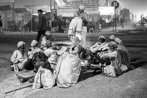 group of babas sitting around a campfire on a street corner - kumbh mela 2013 (india), babas, beard, campfire, circle, hindu, hinduism, kumbha mela, maha kumbh mela, men, night, pilgrim, sadhus, sitting, street, yatri