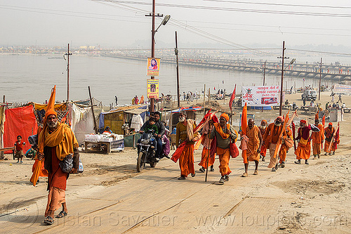 group of hindu pilgrims walking - kumbh mela 2013 (india), babas, bhagwa, floating bridge, foot bridge, ganga river, ganges river, group, hindu, hinduism, infrastructure, kumbha mela, maha kumbh mela, men, pilgrims, pontoon bridge, river bank, sadhu, saffron color, walking, water, yatris