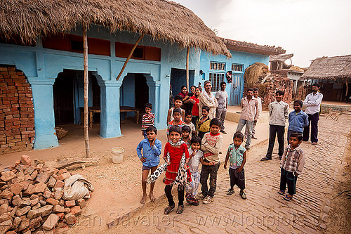 group of kids and men in indian village, blicks, blue house, children, crowd, khoaja phool, kids, men, village, खोअजा फूल