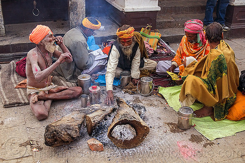 group of sadhus (hindu holy men) sitting near their bonfires (nepal), baba, beard, bonfire, cross-legged, festival, hindu, hinduism, kathmandu, maha shivaratri, man, pashupati, pashupatinath, sadhu, sitting, smoke