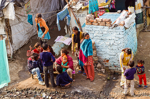 group of women and children in village (india), children, cloth lines, familly, gathering, kids, shanty house, shanty town, village, women