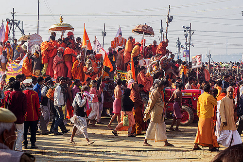 guru float pulled by tractor arrives at the sangam - kumbh mela (india), crowd, float, gurus, hindu, hinduism, kumbh maha snan, kumbha mela, maha kumbh mela, mauni amavasya, parade, procession, umbrellas, walking