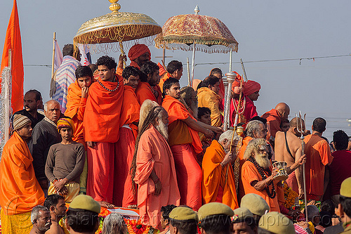 gurus and hindu devotees on parade float - kumbh mela (india), bhagwa, crowd, float, gurus, hindu pilgrimage, hinduism, india, kumbh maha snan, maha kumbh mela, mauni amavasya, parade, saffron color, umbrellas