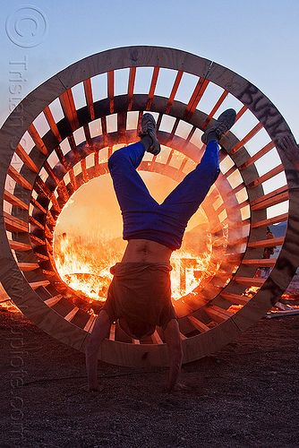 handstand near fire, burning man, cylinder, cylindrical, dusk, fire, flames, frame, hand stand, wood, wooden