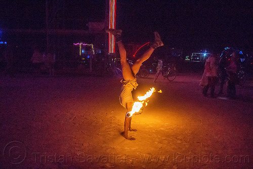 handstand with fire staff - burning man 2015, burning man, fire dancer, fire dancing, fire performer, fire spinning, fire staff, flame, handstand, night, woman