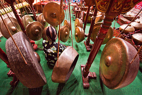 hanging gongs, bossed gongs, gamelan ensemble, gong ageng, gong group, hanging gongs, java, jogja, jogjakarta, karawitan, man, music, musical, nipple gongs, percussion, player, ropes, sitting, suspended gongs, yogyakarta