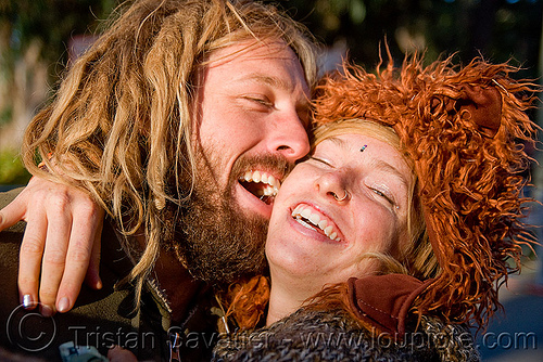 happy young couple embracing - gabrielle and henry, bluegrass, couple, embracing, festival, fuzzy hat, gabrielle, golden gate park, hardly, henry, hippies, kiss, kissing, lovers, man, strictly, woman