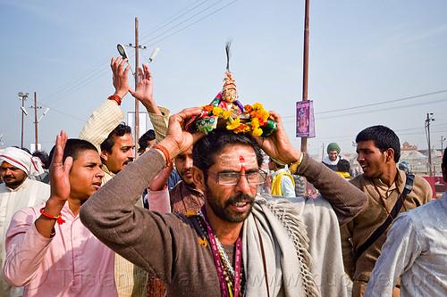 hare krishna devotee holding deity statue over his head - kumbh mela 2013 (india), ceremony, dancing, hare krishna, hindu, hinduism, kumbha mela, maha kumbh mela, men, paush purnima, procession, tilak, tilaka
