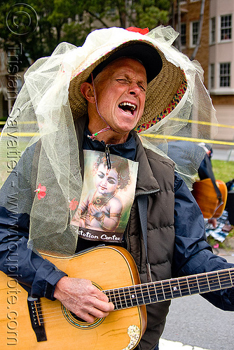hare krishna singing and playing guitar, bay to breakers, festival, footrace, hat, lace, man, meditation center, people, street party