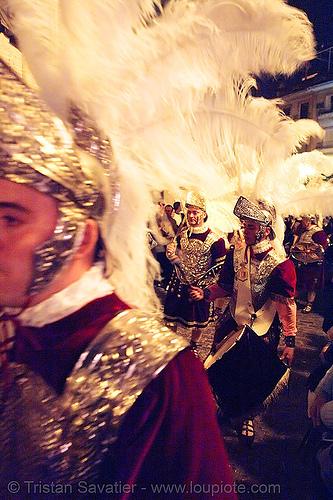 hermandad de la macarena - semana santa en sevilla, andalucía, candles, capirotes, cofradía, easter, helmet, hermandad de la macarena, metal armor, nazarenos, night, parade, procesión, procession, religion, roman soldiers, semana santa, sevilla, soldier, white feathers
