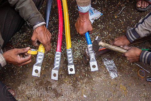 high voltage cables and connectors, connectors, delhi, electric, electrical tape, electricity, hammer, hammering, hands, high voltage, india, power cables, workers, working