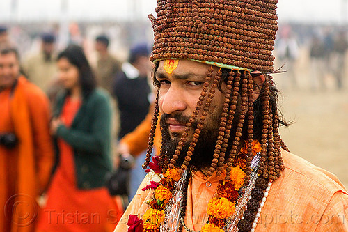 hindu devotee with hat made of rudraksha beads, baba, beard, guru, headdress, headwear, hinduism, kumbh mela, kumbha mela, maha kumbh, maha kumbh mela, man, necklaces, people, sadhu, tilak, tilaka